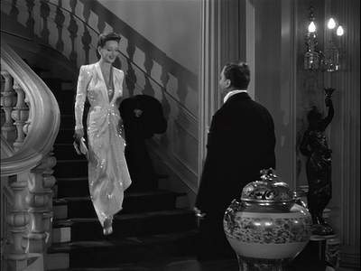 Bette-davis-now-voyager-long-shiny-evening-gown-on-stairs